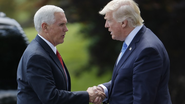 President Donald Trump shakes hands with Vice President Mike Pence, before walking across the South Lawn of the White House in Washington, Friday, May 19, 2017, to board Marine One for a short trip to Andrews Air Force Base, Md. Trump is leaving for his first foreign trip, visiting Saudi Arabia, Israel, Vatican, and a pair of summits in Brussels and Sicily. (AP Photo/Pablo Martinez Monsivais)